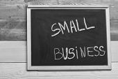 Small Business Type Concept. Chalkboard With Small Business Sign On Wooden Background. Small Busines poster