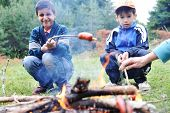 stock photo of boy scout  - Barbecue in nature - JPG