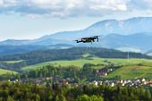 Aerial Photography And Videography. Drone Flying Over Mountain Fields. poster