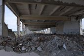 foto of rip-rap  - ruins of a devastated warehouse with building materials on the ground - JPG