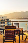 Summer Outdoor Balcony With Garden Furniture In Sea And Sunset Overview. Penthouse Apartments Resort poster