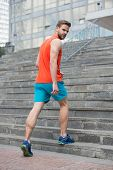 Man In Active Wear And Sneakers On Steps. Sportsman Workout On Stairs. Fit And Confident. Future And poster
