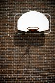Basketball Hoop On Brick Wall