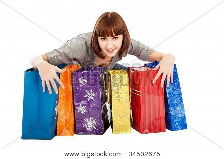 Young Smiling Woman With Colored Shopping Bags