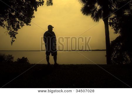 Man by the Waterfront Silhouette