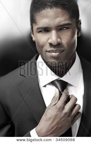Sexy young stylish businessman in black and white suit