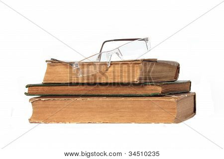 Three Old Books And Glasses
