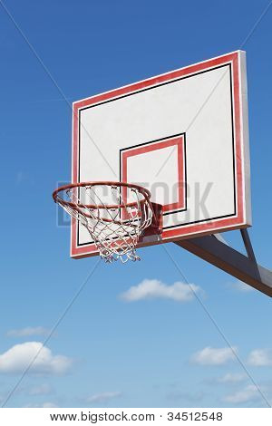 Basketball hoop on blue sky background