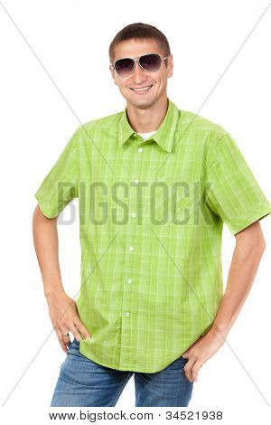 Portrait Of A Handsome Fashion Man In Sunglasses In Casual Clothes. Isolated Over White.