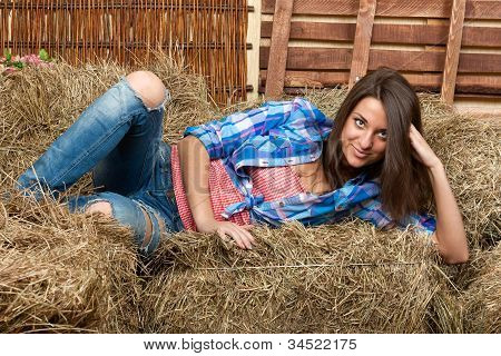 The Beautiful Girl Lies On A Haystack