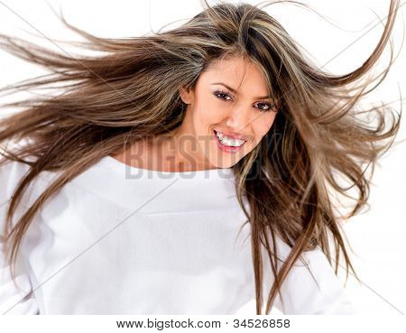 Woman with gorgeous long hair against the wind - isolated over white