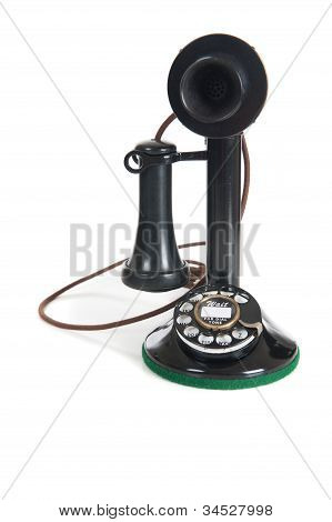 Black Antique phone on a white background