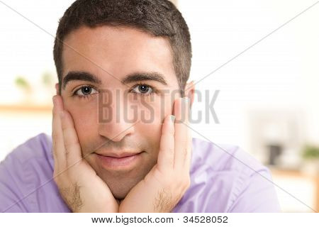 Cute Young Professional Hands Cradling Face