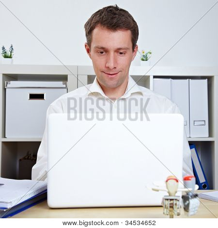 Manager working at his desk with laptop in the office