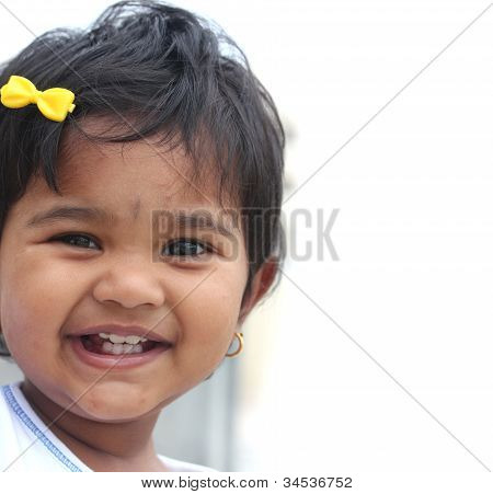Photo Of Pretty And Happy Indian Baby Girl With Expressive Eyes And Photogenic Face Expressing Toddl