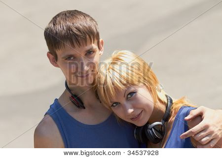 Young Couple With Headphones Posing