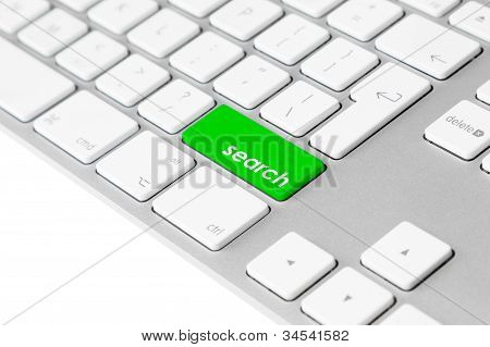 "Computer keyboard with green ""search"" button"