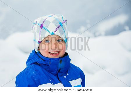 Winter boy throwing snowball