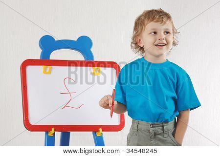 Little smiling blond boy drew a pound sign on the whiteboard