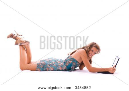 Beautiful Woman Using Laptop, Lying On The Floor.