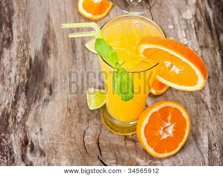 Orange cocktail on wood, top view
