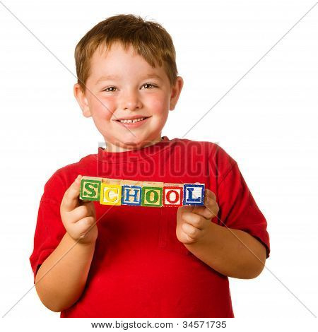 "Preschool education concept with child holding blocks that spell out ""school"""
