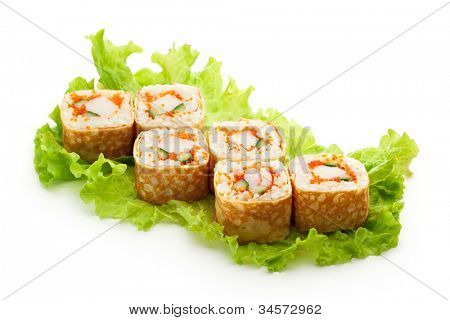 Omelet Maki Sushi - Roll made of Crab Meat, Cucumber and Tobiko inside. Tamago (Japanese Omelet) ouside