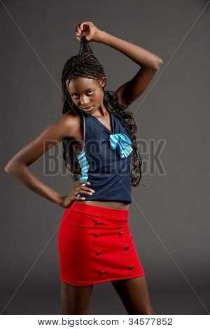 A Beautiful black woman in a red skirt
