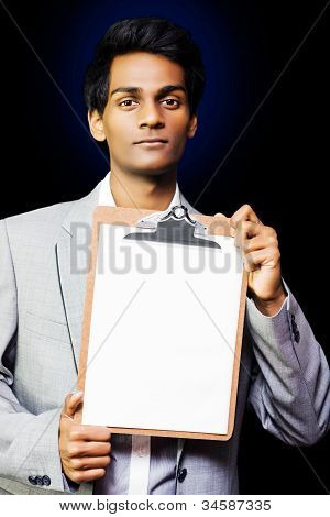 Young Professional Man With Clipboard