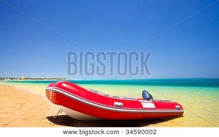 Lifeboat And Coastline Summertime.