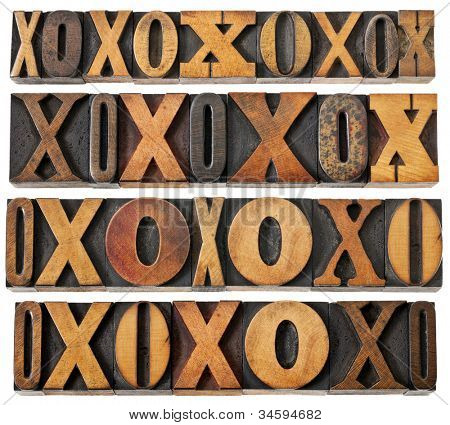 letters O and X in vintage letterpress wood type - four rows of different fonts - decoration or design elements