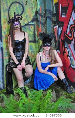 Two beautiful women in a costume masks