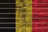 National Flag  Of Belgium On A Wooden Wall Background. The Concept Of National Pride And A Symbol Of poster