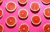Flat Lay Composition With Tasty Ripe Grapefruit Slices On Magenta Background poster