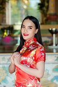 Happy Chinese New Year. Asian Girl With Gesture Of Congratulation poster
