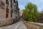 Picturesque View Of The Promenade Along The River Arlanza In The Village Of Covarrubias poster