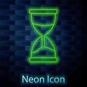 Glowing Neon Line Old Hourglass With Flowing Sand Icon Isolated On Brick Wall Background. Sand Clock poster