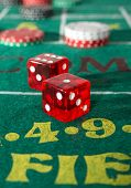 image of crap  - Craps table with casino chips and dice - JPG