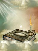 stock photo of storybook  - Fantasy storybook in the sky with candle - JPG