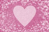 Shiny Pink Background With Glitter Effect And Heart Shaped Bokeh. Big Pale Heart In The Center poster