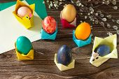 Childrens Gift Easter Egg Wrapping On A Wooden Table. Handmade. The Project Of Childrens Creativit poster