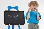 stock photo of einstein  - Little amazed boy with glasses shows Einstein - JPG