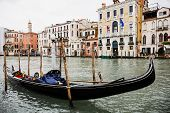 Canal With Gondola And Ancient Buildings In Venice, Italy poster