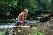Yoga Practice And Meditation In Nature. Man Practicing Near River. poster