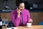 Beautiful Woman Calling Room Service In Hotel Room. Woman Speaking With Room Service In Hotel Room.  poster