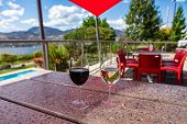 Red Wine And White Wine Glasses Selective Focus, On Terrazzo Table In Restaurant Patio, Outdoor Wine poster