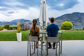 Caucasian Young Man And Woman Couple Back Rear View As They Tasting Wines In Restaurant Beautiful Pa poster