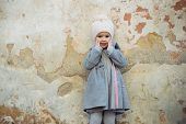 Happy Little Girl Child. Autumn Fashion. Childrens Day. Little Girl In Vintage Coat On Grunge Backgr poster