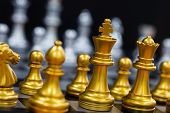 The King In Battle Chess Game Stand On Chessboard With Black Isolated Background. Business Leader Co poster