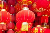 Handmade Fabric red lanterns hanging for Chinese new year in a chinatown. The chinese he on lanter poster